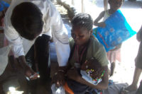 A child in Angola gets vaccinated.