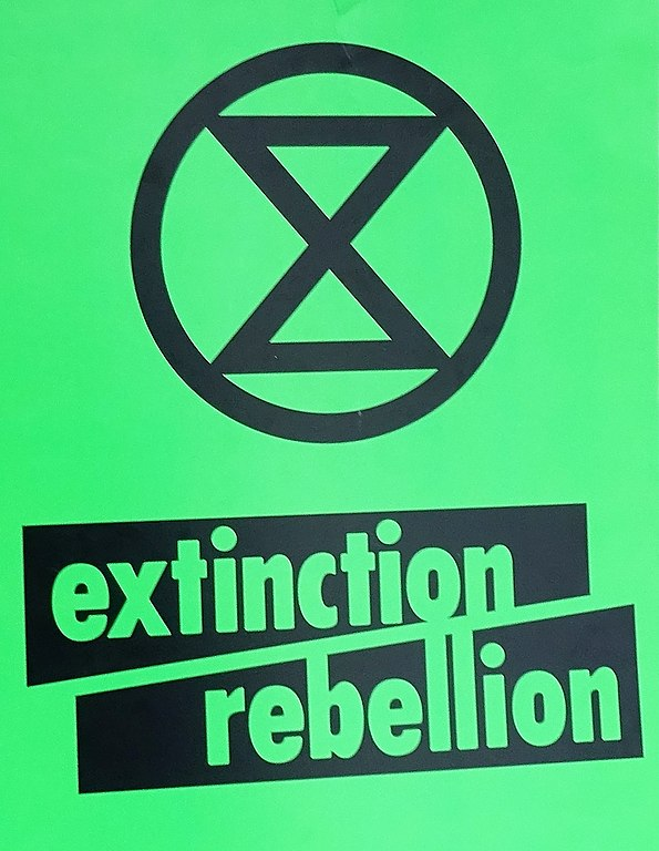 Extinction Rebellion, green placard.