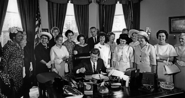 American Association of University Women members with President John F. Kennedy as he signs the Equal Pay Act into law
