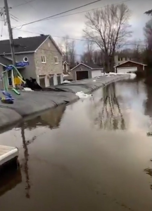An emergency wall to protect homes from flood waters in Cumberland, Ontario.