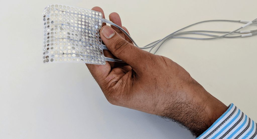 Gopala Anumanchipalli, PhD, holding an example array of intracranial electrodes of the type used to record brain activity in the current study. Credit: UCSF