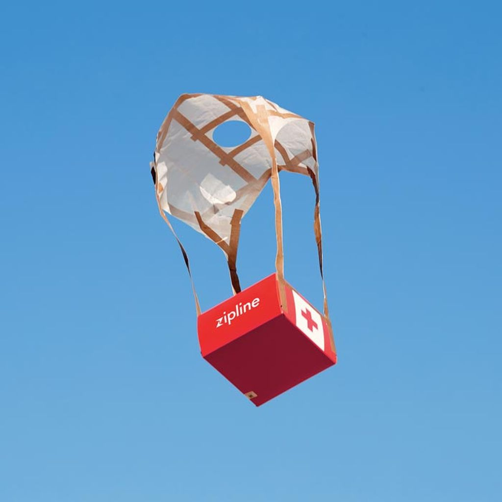 Medical supplies descend by parachute.