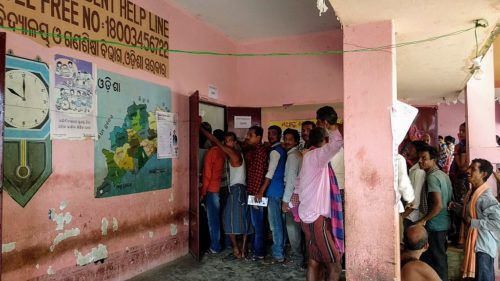 Indian citizens standing in a queue to vote during 2019 elections in Jaydev constituency, Odisha