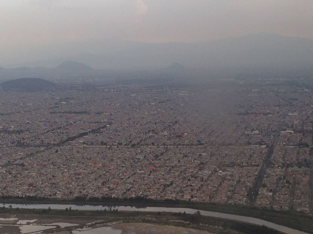 Flying over Mexico City, Mountains, smog
