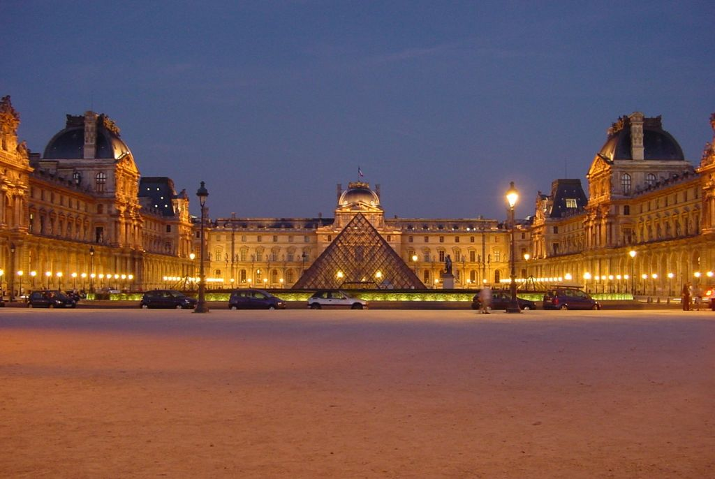 The court of the Louvre with its pyramid at night.