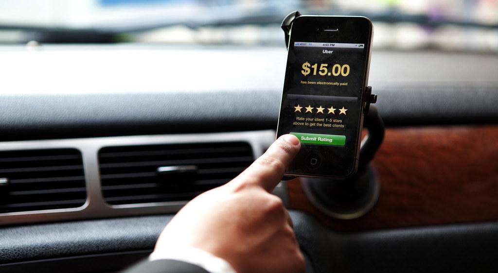 Uber driver rating passenger, fare shown.