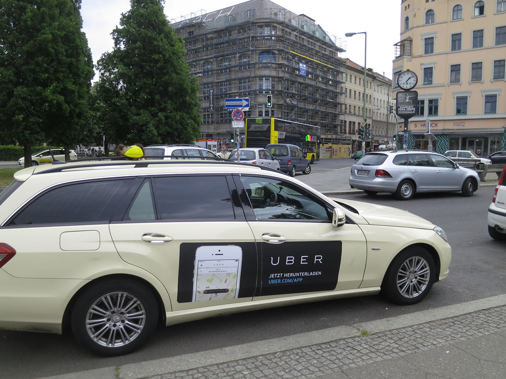 Uber taxi ad on Station wagon in Berlin.