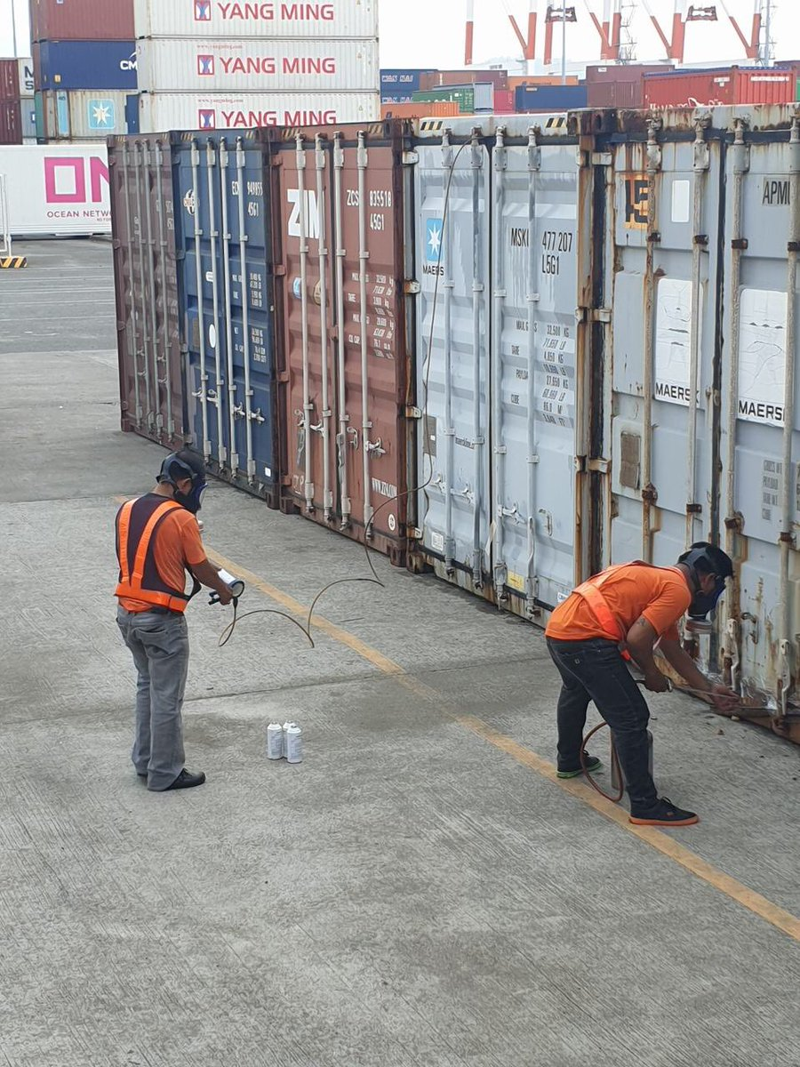 Spraying the containers before shipping.