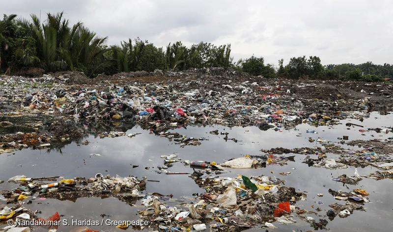 Waterway clogged with plastic in Malaysia.