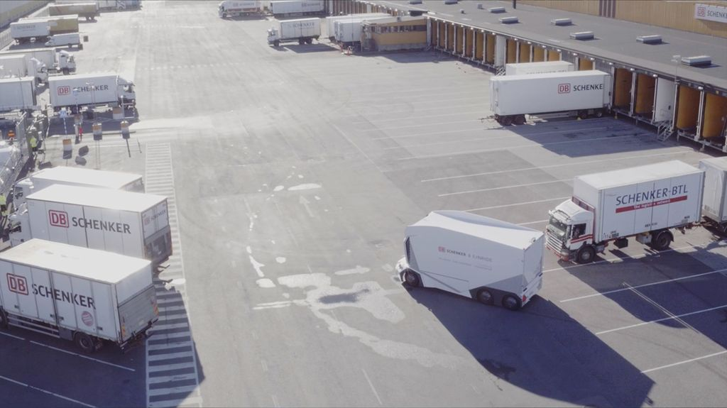 An Einride driverless T-Pod in a parking lot with other trucks.