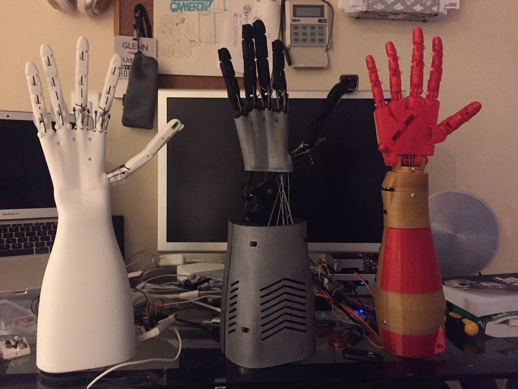 Three versions of Glenn Cameron's robotic hand.