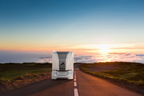 An Einride driverless T-Pod drives down a highway.