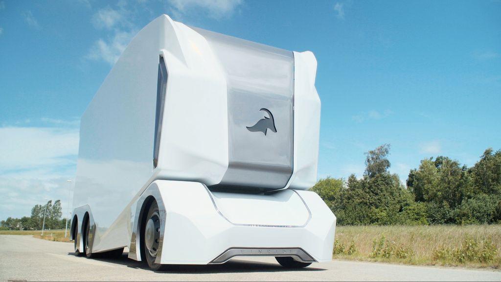 An Einride driverless T-Pod drives down a highway.