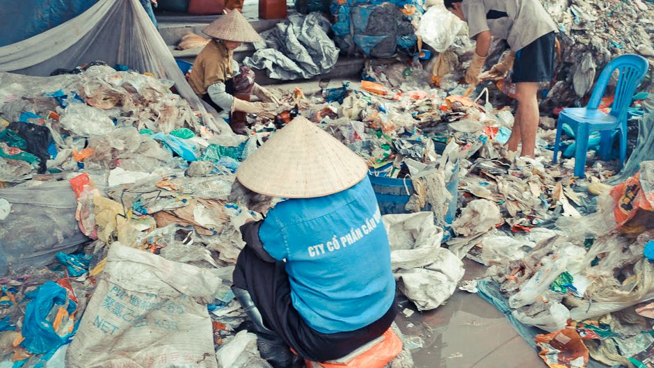Vietnamese women recycling all sorts of discarded plastic, including from waste streams.