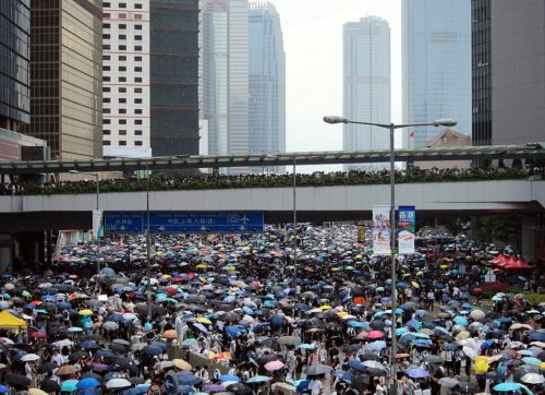 Protesters fill the streets on Harcourt Road, Admiralty, Hong Kong at 13:30 on 12 June 2019, adjacent to the Central Government Complex.