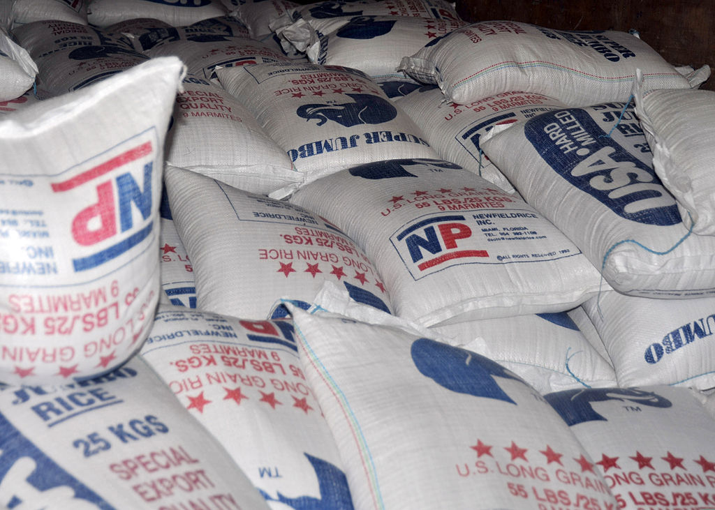 Piles of 55-pound bags of rice that will be distributed by the World Health Organization are photographed Jan. 31, 2010
