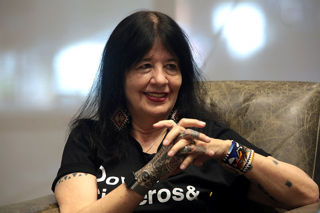 """Joy Harjo speaking with attendees at an event titled """"Legacies: A Conversation with Sandra Cisneros, Rita Dove and Joy Harjo"""""""