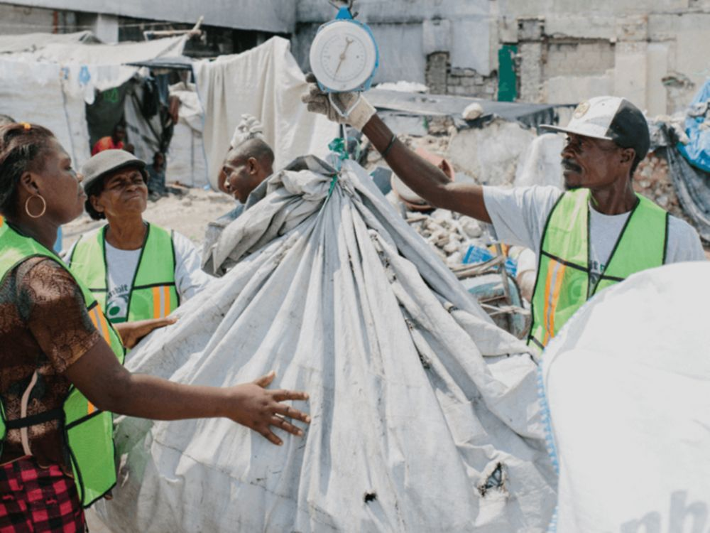 Weighing recycling in Haiti.
