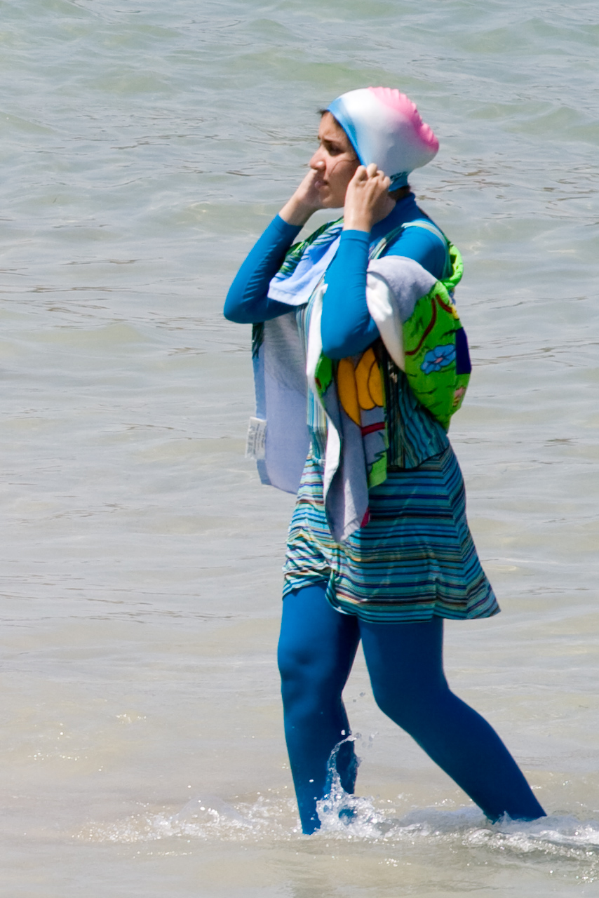 girl in fashionable burkini sighted on the beach of Alexandria