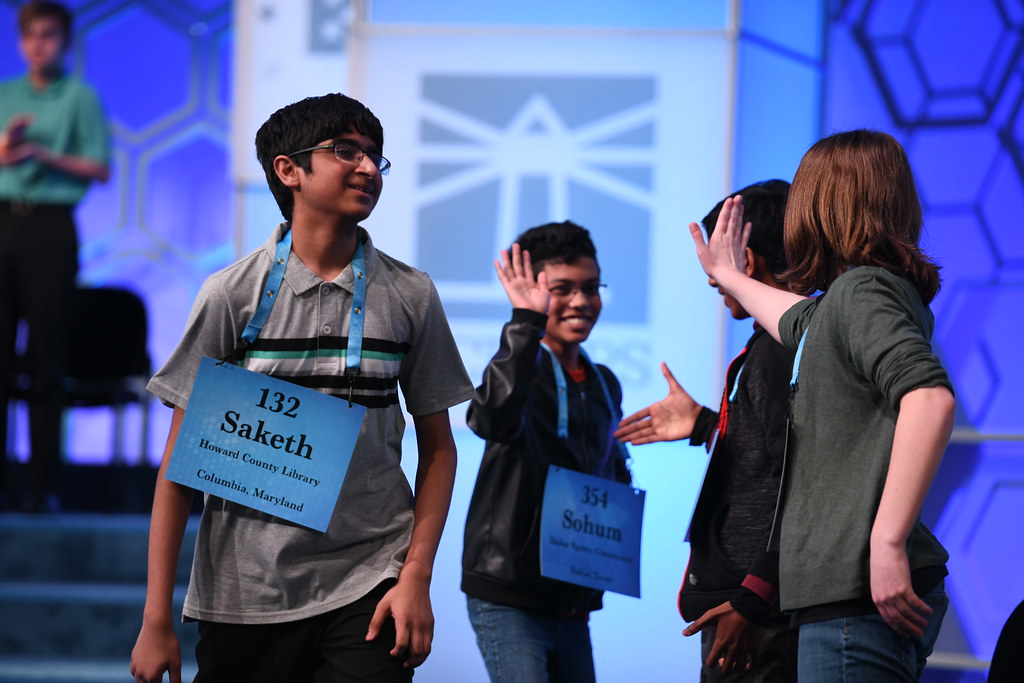Students high-five each other at the 2019 Scripps National Spelling Bee.