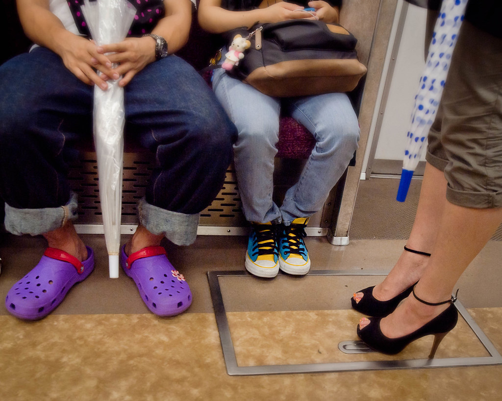 Tokyo Metro Foot Fashions - A small sampling of the wide variety of footwear sitting side by side on the Tokyo subways.
