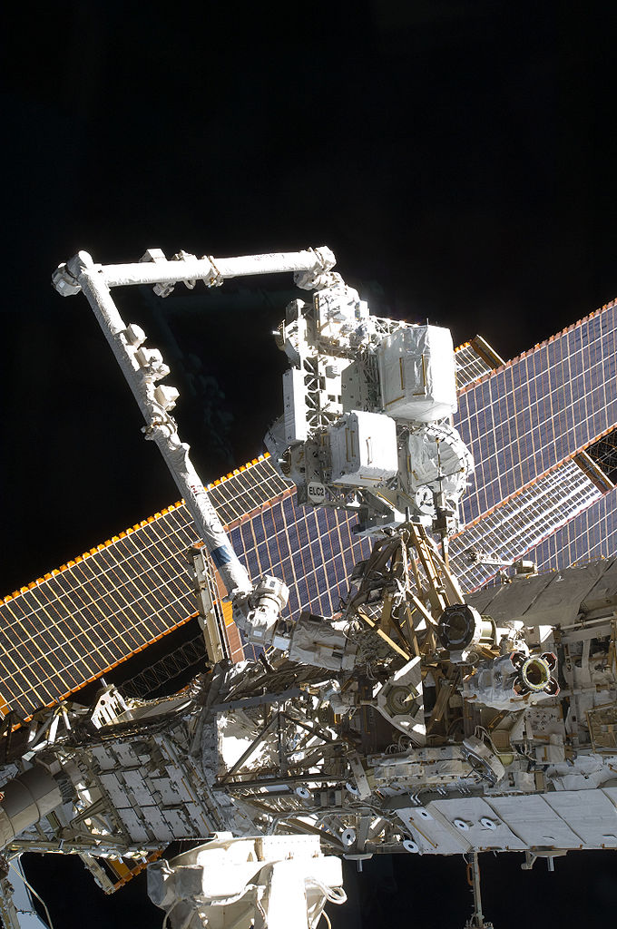 The Canadarm2 or the Space Station Remote Manipulator System mates the Express Logistics Carrier (ELC) 2 to the Zenith / Outboard Payload Attachment System (PAS) on the S3 Truss aboard the International Space Station, as controlled by Atlantis and station crews in the shirt sleeve environment of the orbital outpost.