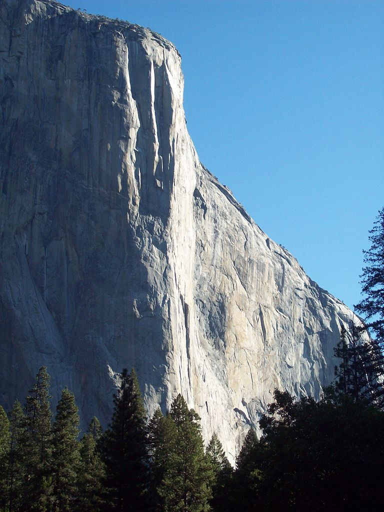 The 2800 foot 'Nose Route' of El Capitan ascends a line meandering for roughly 30 rope lengths in the vicinity of where the sun meets the shade.