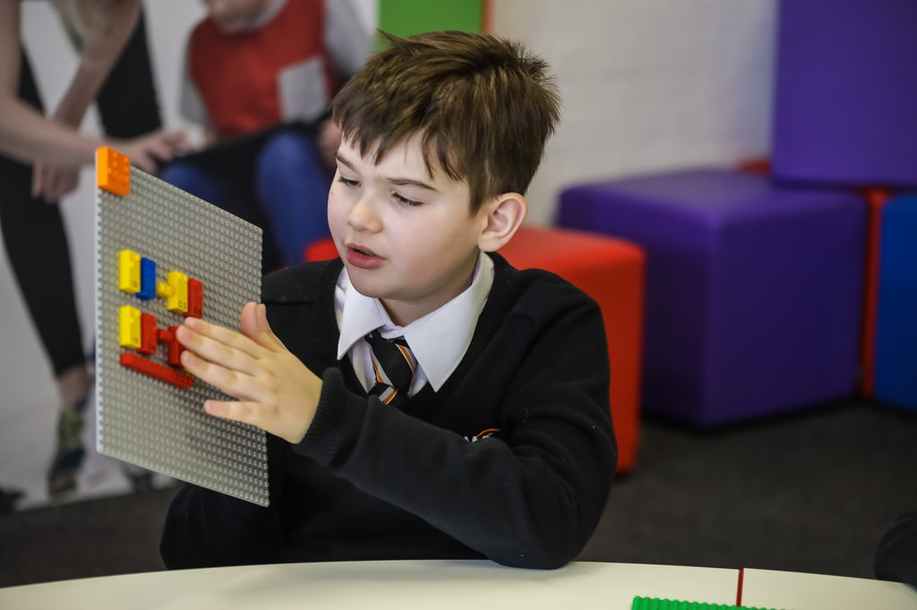 A student works with Lego's Braille bricks to learn math.