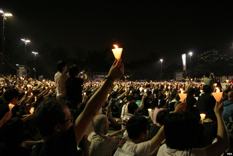 In 2013, people in HK remember the victims of the Tiananmen violence.