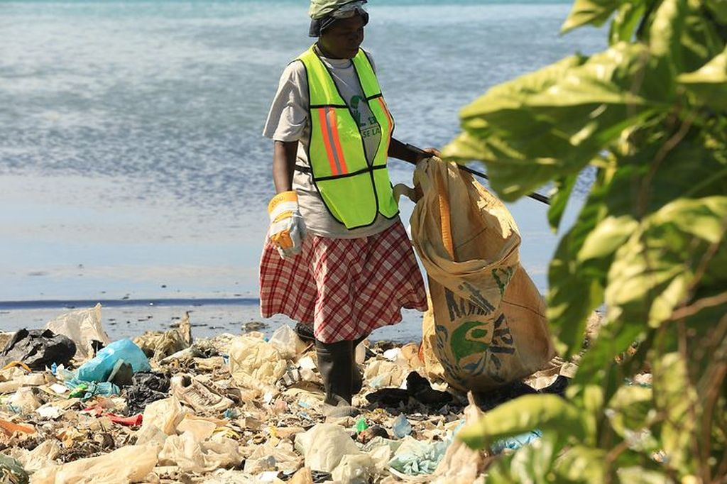 Collecting recycling in Haiti.