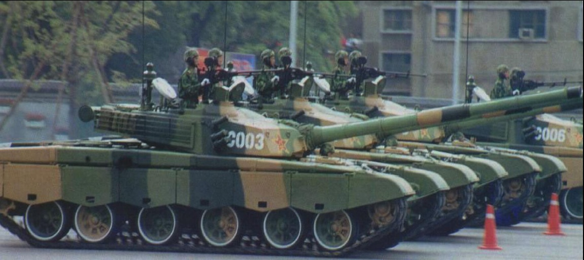 Chinese Type 98 MBTs on parade in Beijing in October. Note new hull skirts, rubber padded tracks, and the raised turret roof.