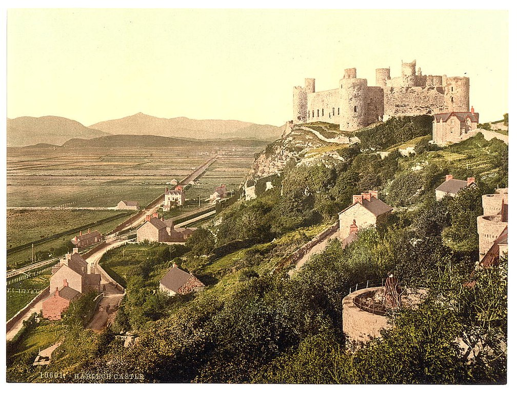 The castle, Harlech Castle, Wales - 1905 picture, showing castle and steep road down.