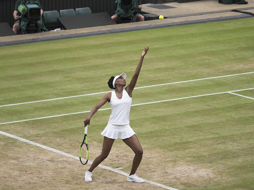 Venus Williams serving at Wimbledon in 2017