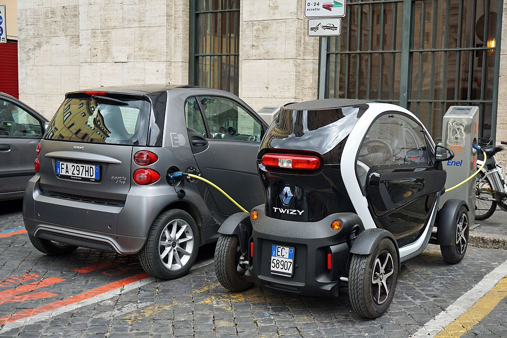 Smart ED and Renault Twizy Z.E. electric cars charging in Rome, Italy