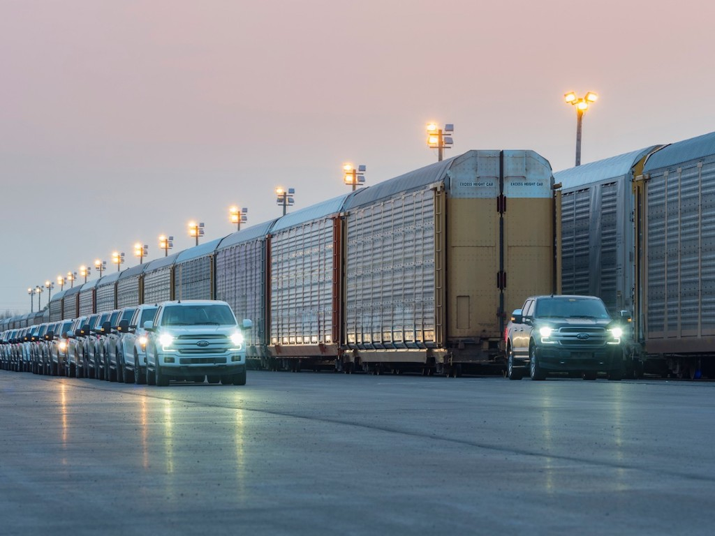 An electric truck made by Ford pulls a 1,000,000 pound train as part of a demonstration.