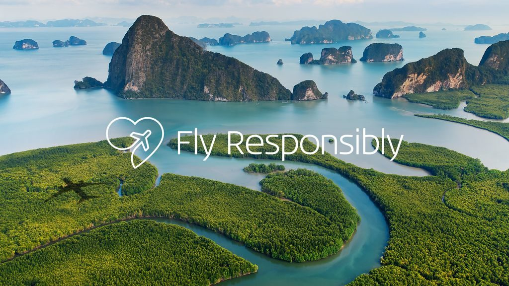 "The words ""Fly Responsibly"" super-imposed on an idyllic nature scene."