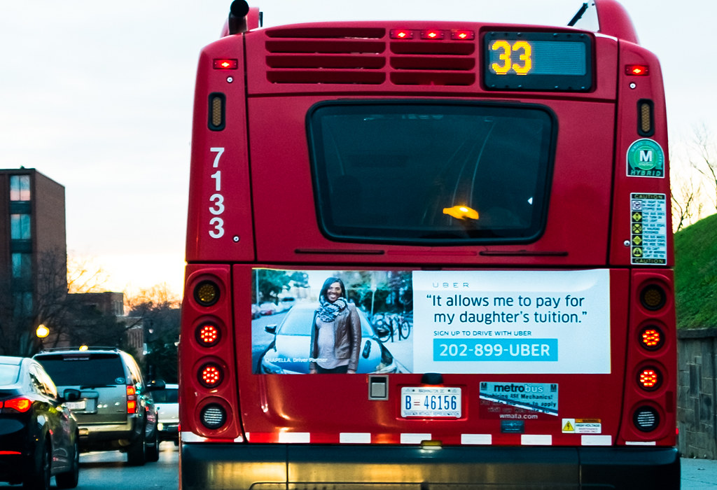 Uber advertisement on a public bus.