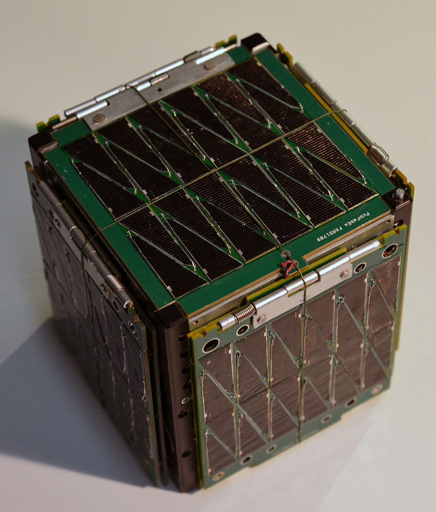 View of the crowdfunded SkyCube cubesat un its undeployed state. Spectra fishing line is used to hold the solar panels in place before deployment.