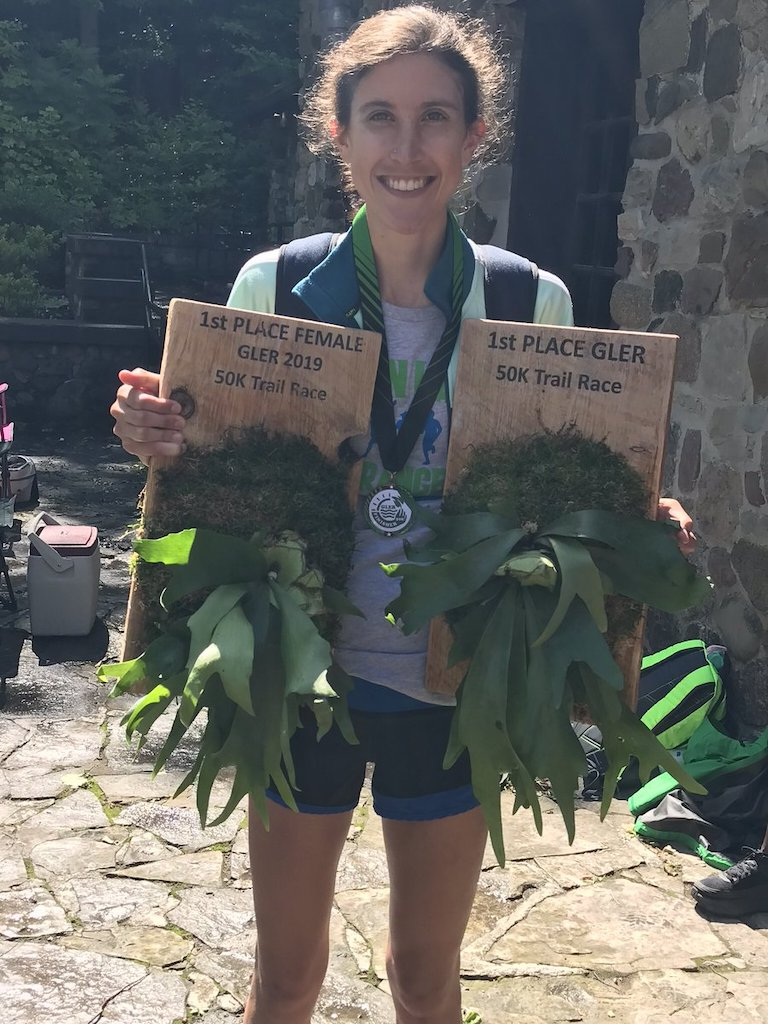 Ellie Pell poses with two trophies - one for 1st place, the other for 1st place female.