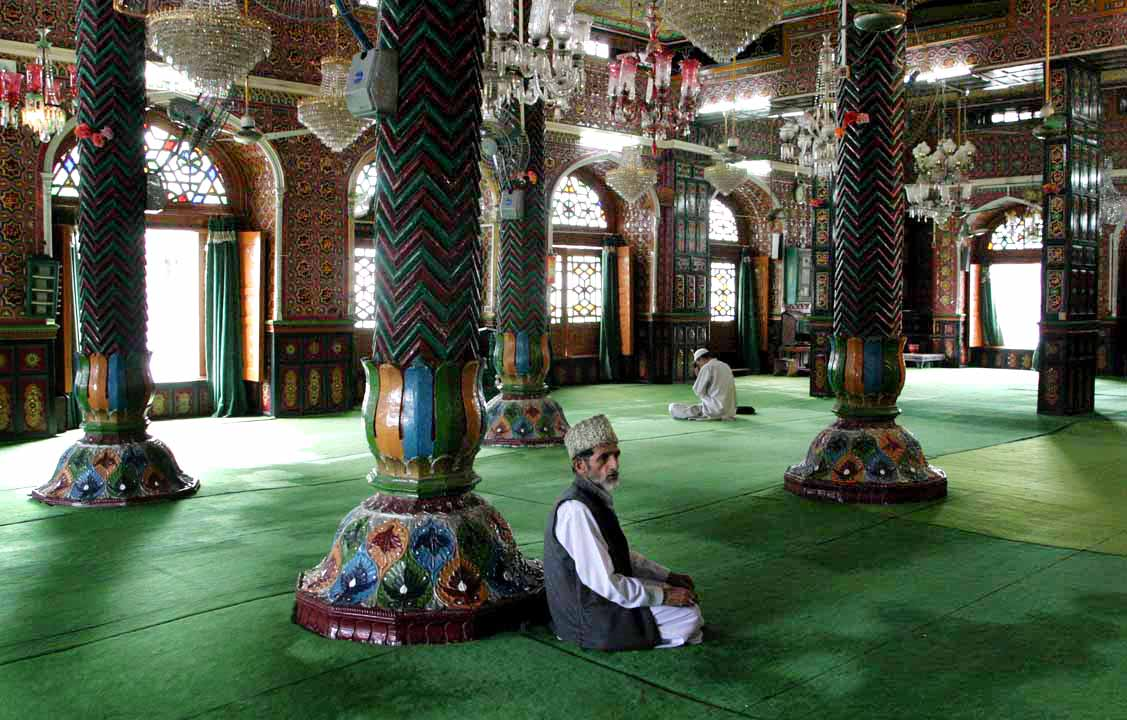 Men in a mosque in Srinagar, Kashmir in India.