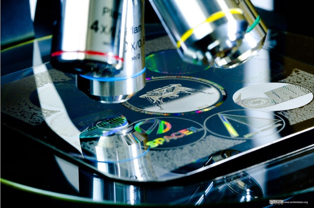 Lunar Library disc under microscopes.