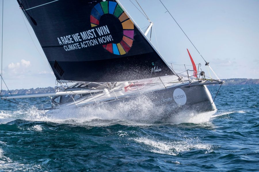 "The racing yacht Malizia II with a sail saying ""A race we must win - climate action now!"""
