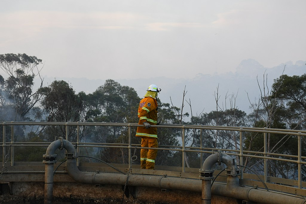 Photo taken of a firefighter looking over Holsworthy during the April 2018 fires 2018-04-15