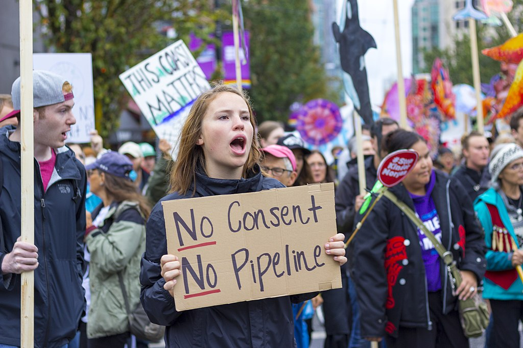 Protester holding sign stating No Pipeline, No Consent, during a Kinder Morgan Pipeline Rally on September 9th, 2017 in Vancouver, Canada.