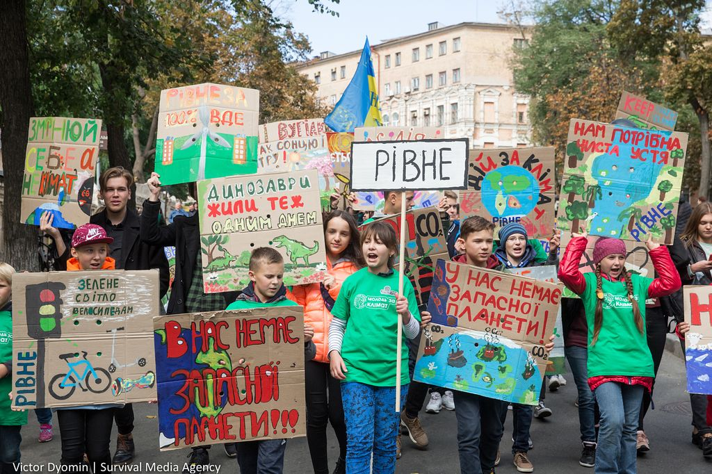 kids with posters chant slogans as climate protesters take action in Kiev, Ukraine on September 20, 2019.
