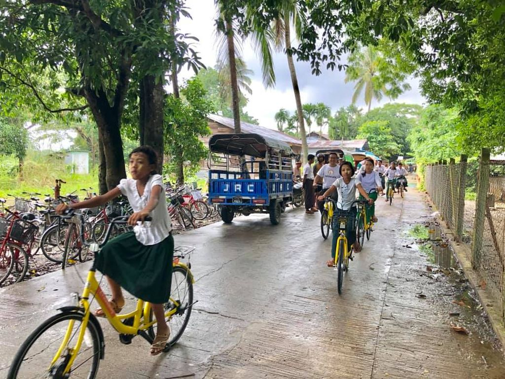 Biking to school in Myanmar.