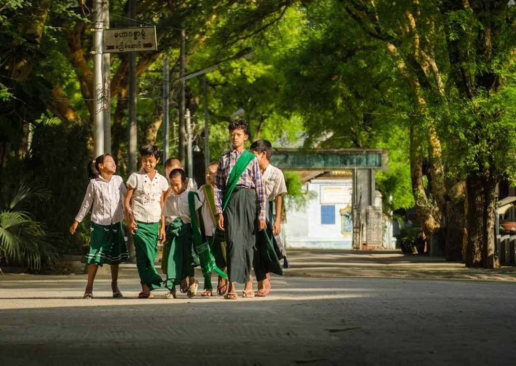Children walking to school in Myanmar.