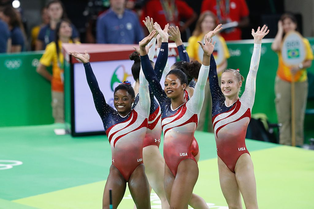 The US gymnastics team is shown waving at the 2016 Olympics in Rio de Janeiro.