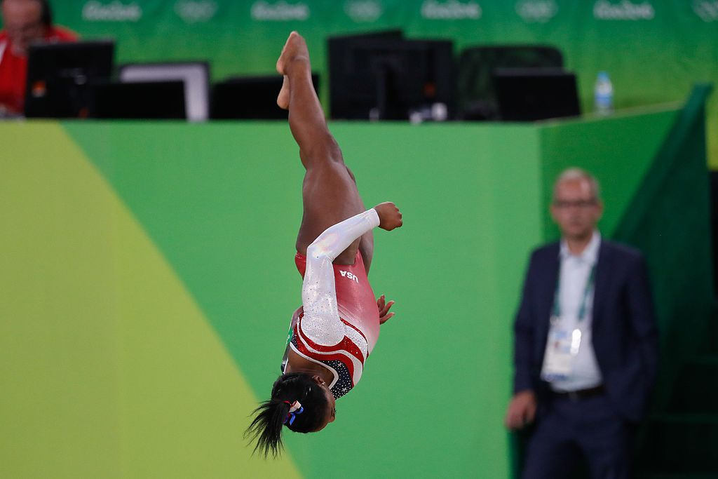 Simone Biles caught upside down during a routine that won a gold medal at the 2016 Olympics in Rio de Janeiro.