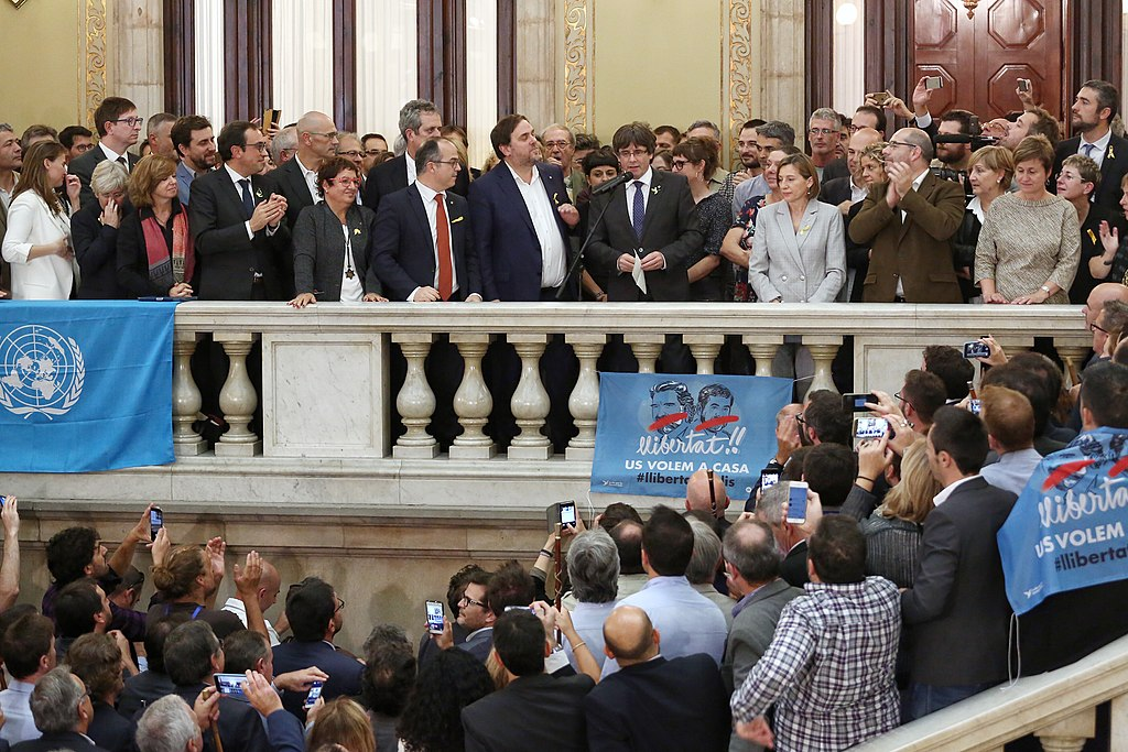 Catalonia's President Carlos Puigdemont speaks outside Parliament with other government leaders a couple of weeks after declaring independence.